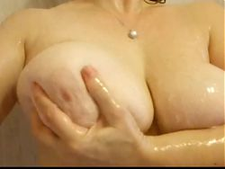 Joyous wet pair of natural tits on lover
